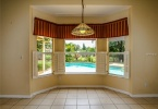 Breakfast nook overlooking private pool and back yard